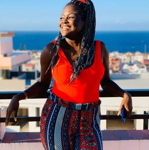 Aaliyah Jade-Brown with a backdrop of the sun-soaked ocean  - (From education to the audio industry)