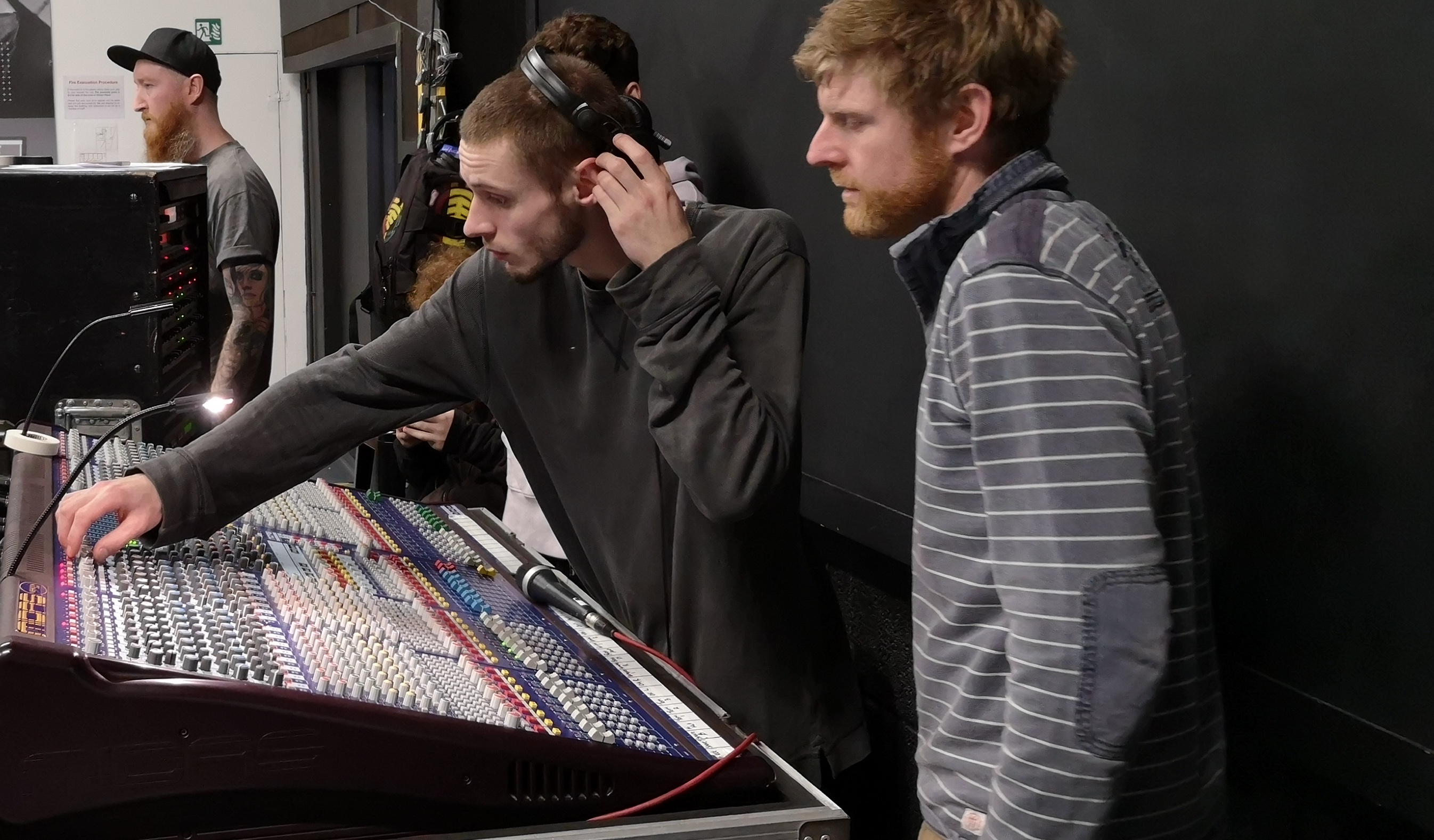 Live sound degree students practice their skills on a mixing desk