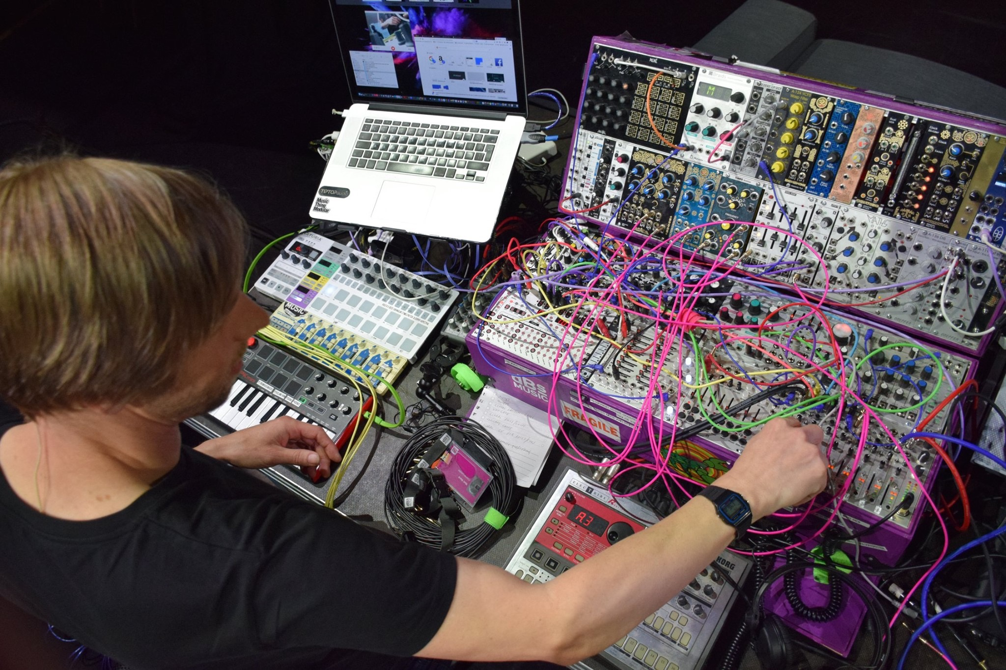 Electronic music production tutor at dBs Institute Matt Ward playing on modular synthesizer