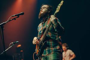 Jack Hale playing bass onstage with Haunt the Woods - (From education to the audio industry)
