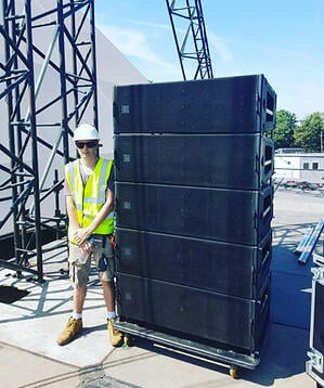 Jerome prepping the speaker rig at a festival